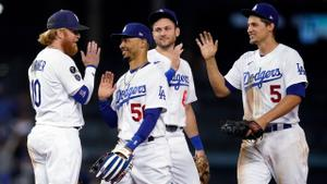 Dodgers celebrate after clinching a 9th consecutive trip to the playoffs