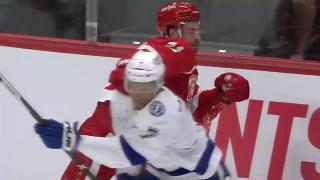 Dylan Larkin takes a swing at Mathieu Joseph after hit into the boards